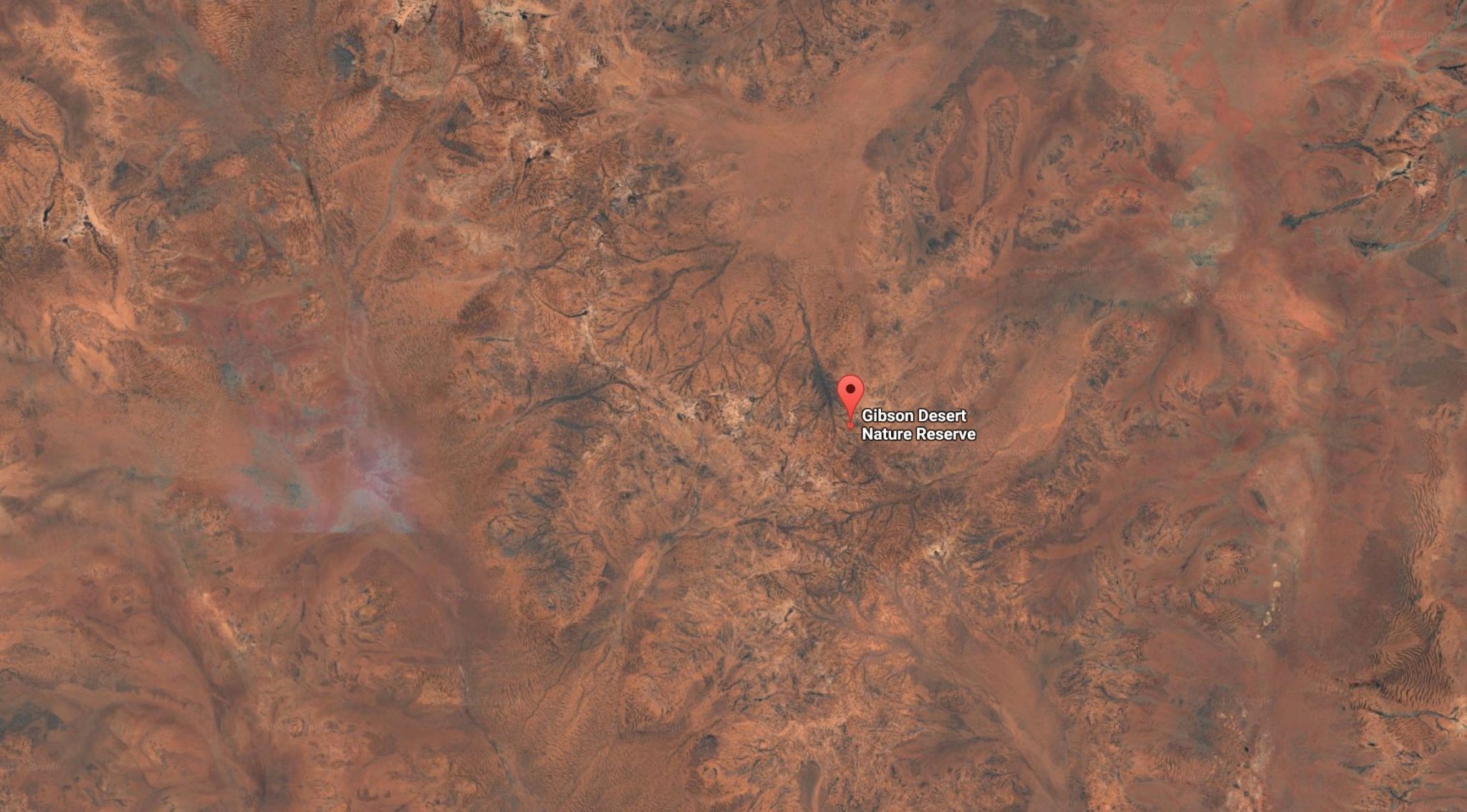 Police search for bogged 4X4 in Gibson Desert.